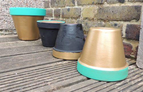 garden sos painted flowerpots