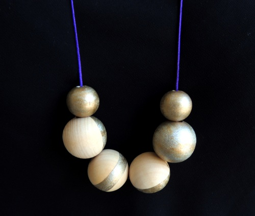 gold dipped bead necklace on black