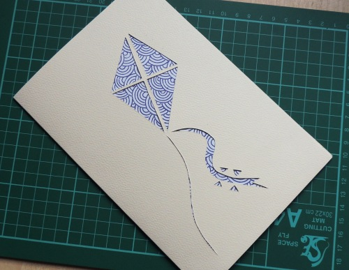papercut card with pattened backing