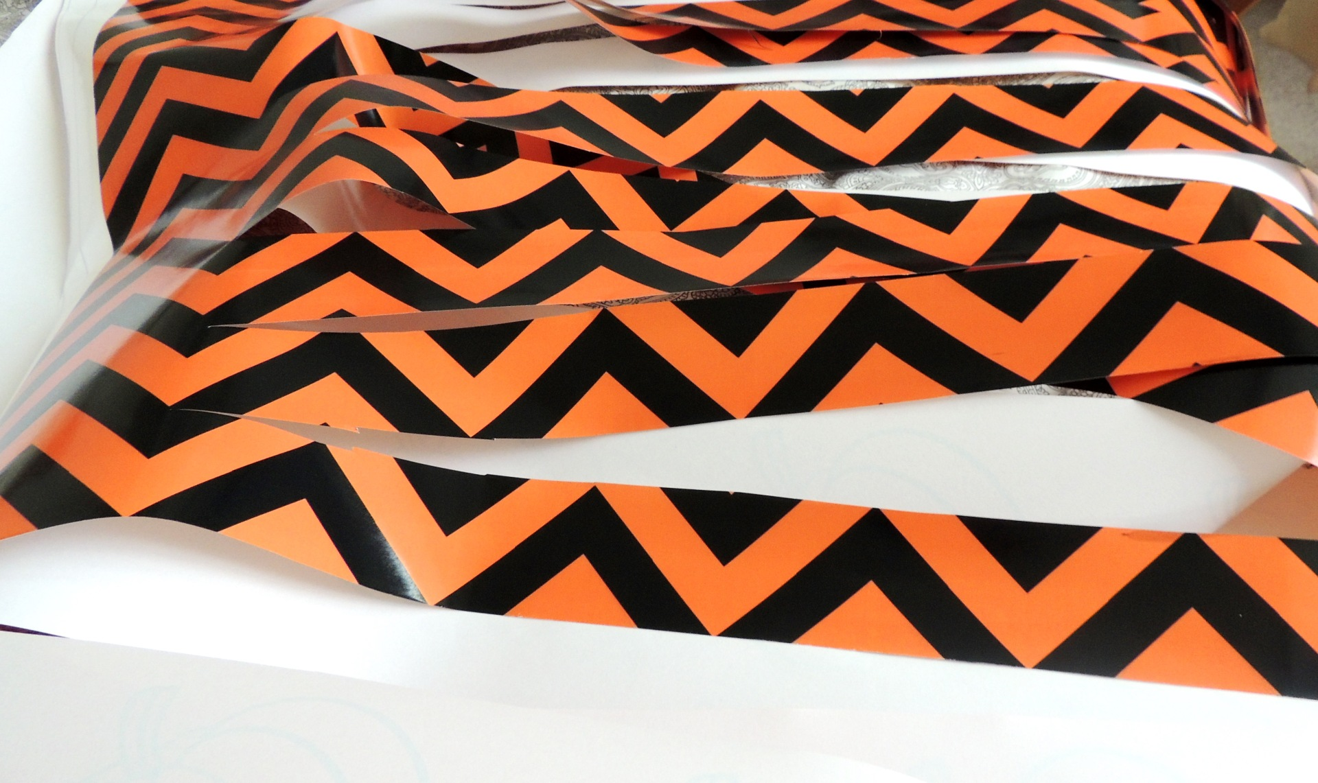cut strips of orange and black paper