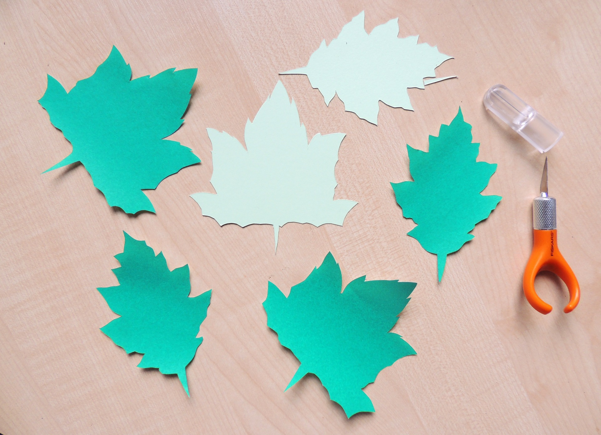 green papercut leaves