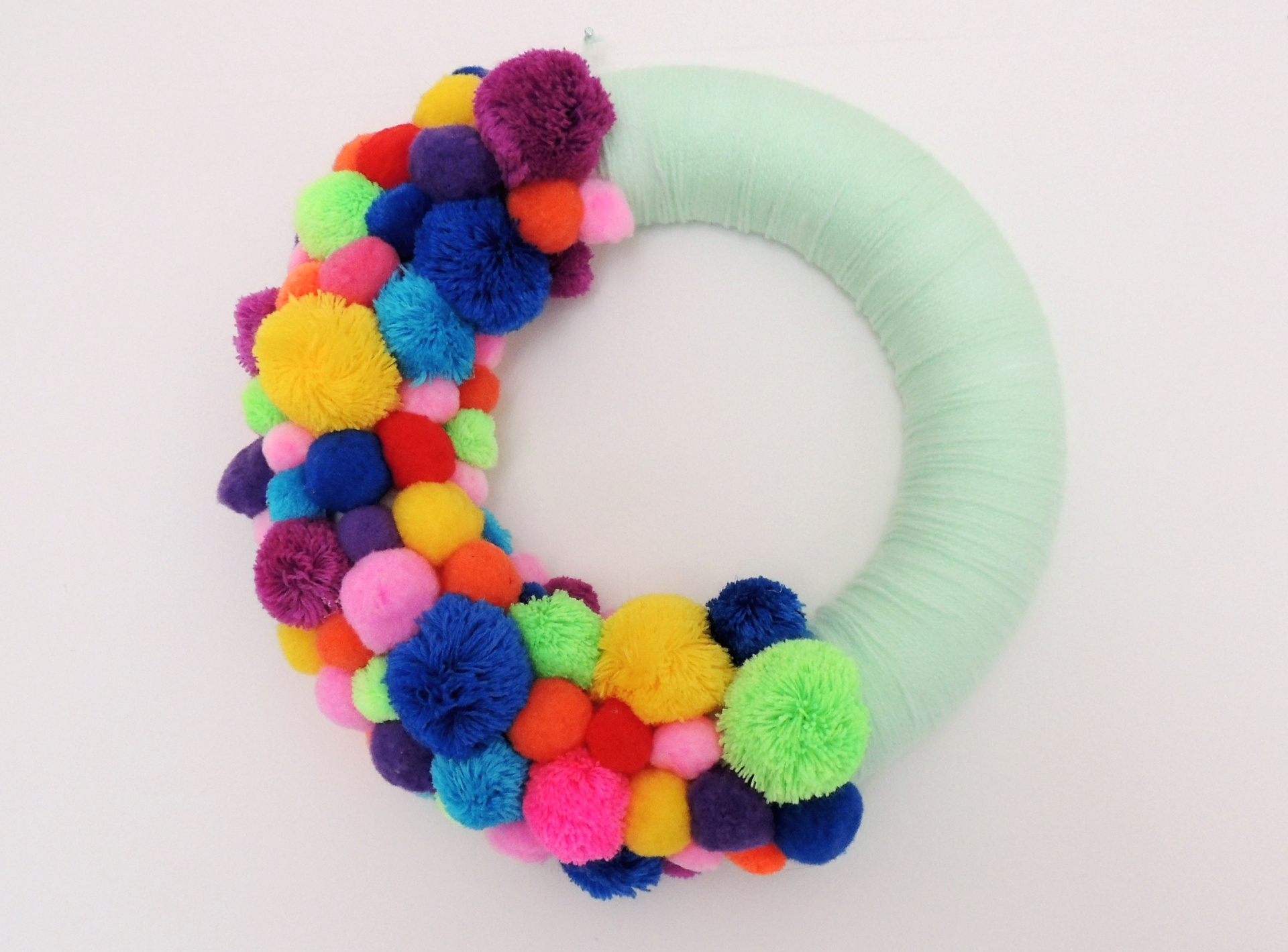 pompom and wool wrapped wreath